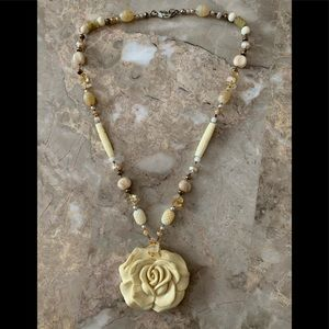 Beautiful necklace with a rose resin pendant